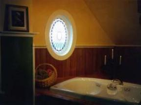 Jacuzzi Alcove with Leaded Rosette Window